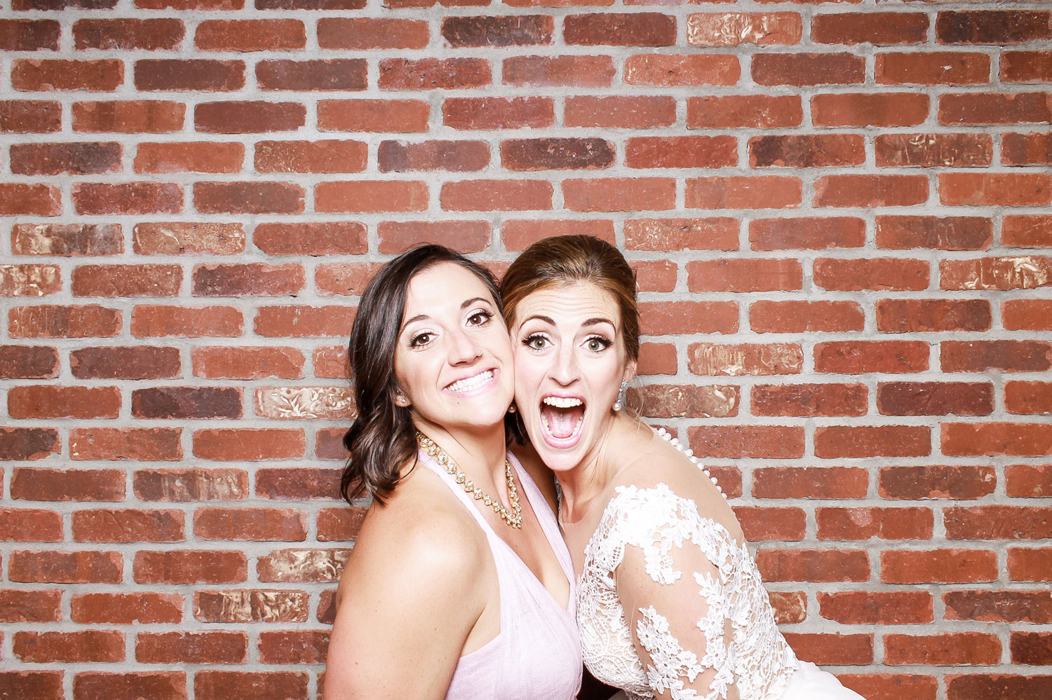 open photo booth brick background