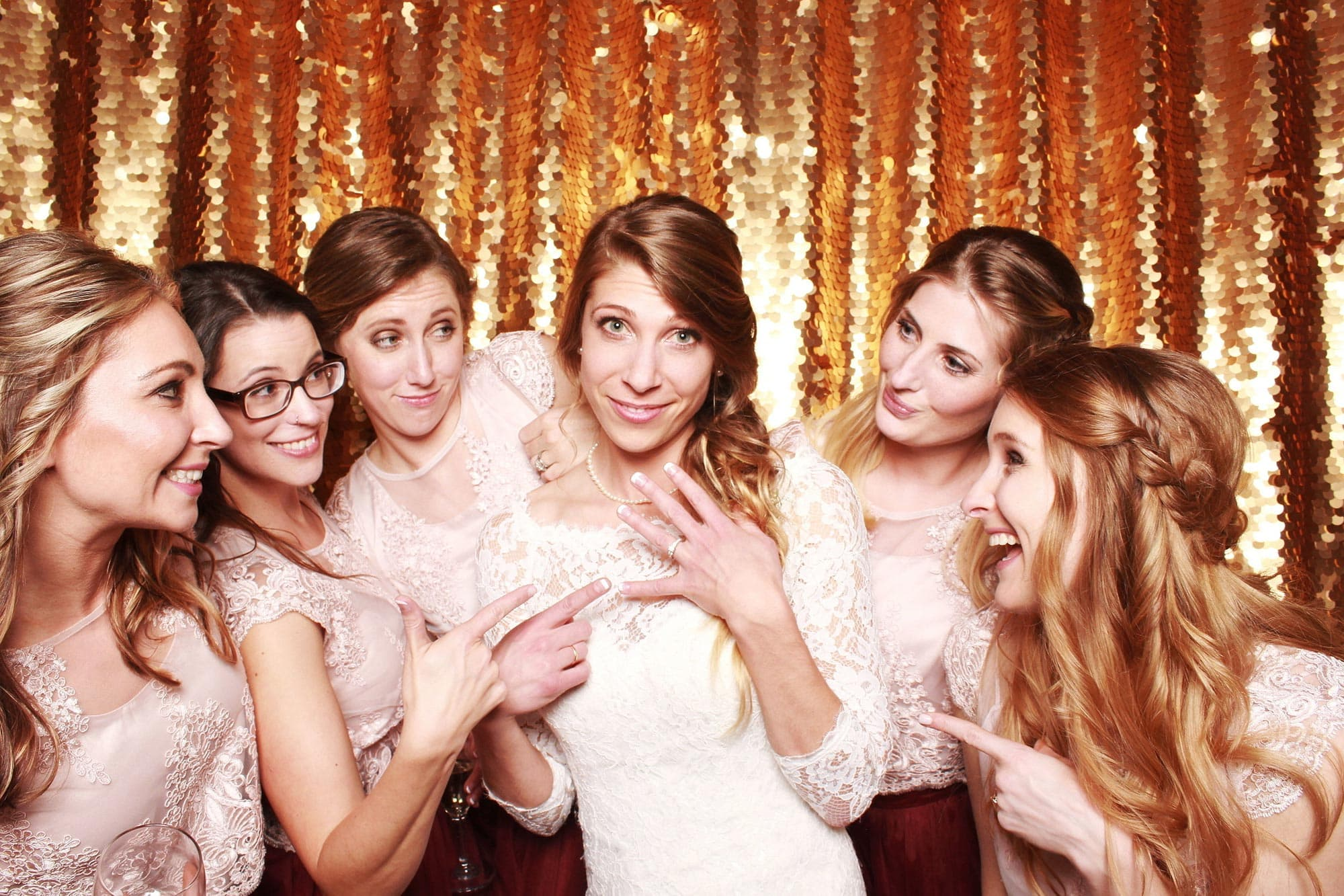 Bridesmaids and wedding party in a photo booth